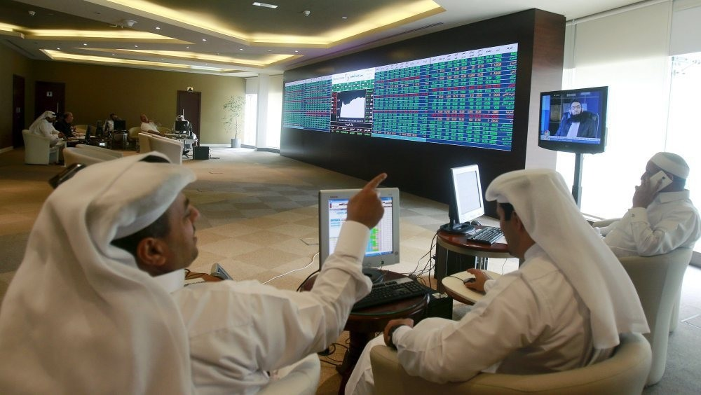 Gulf investors, such as these seen watching an electronic share price display at the Doha Stock Exchange in downtown Doha, Qatar, are among those expacted to be invited by the government to promote Sukuks.