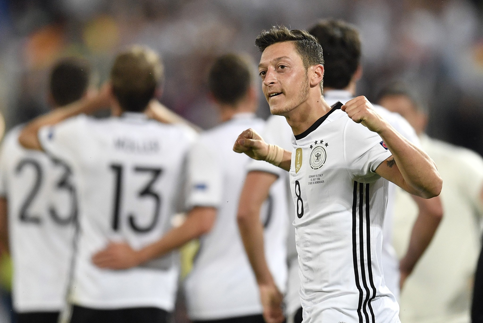 Germany's Mesut Ozil celebrates after scoring the opening goal during the Euro 2016 quarterfinal soccer match between Germany and Italy. (AP Photo)