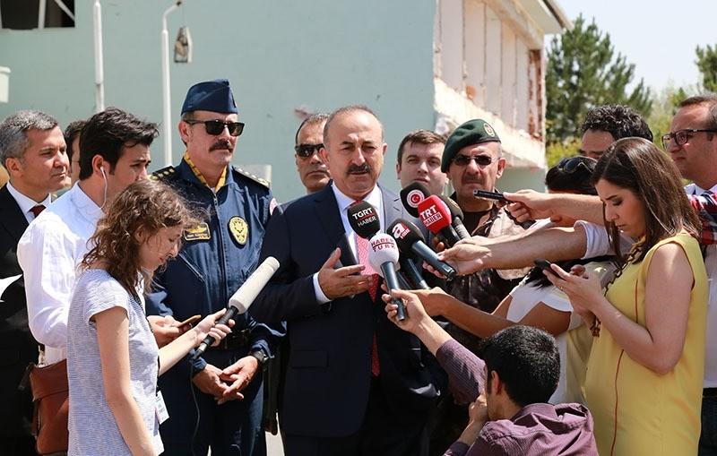 Foreign Minister u00c7avuu015fou011flu speaking to reporters at Special Forces Headquarters in Gu00f6lbau015fu0131, Ankara (IHA Photo)
