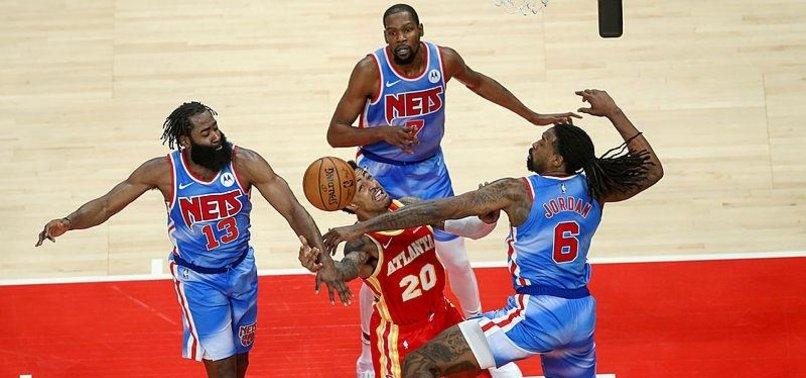 BIG THREE CARRY NETS PAST HAWKS IN OVERTIME
