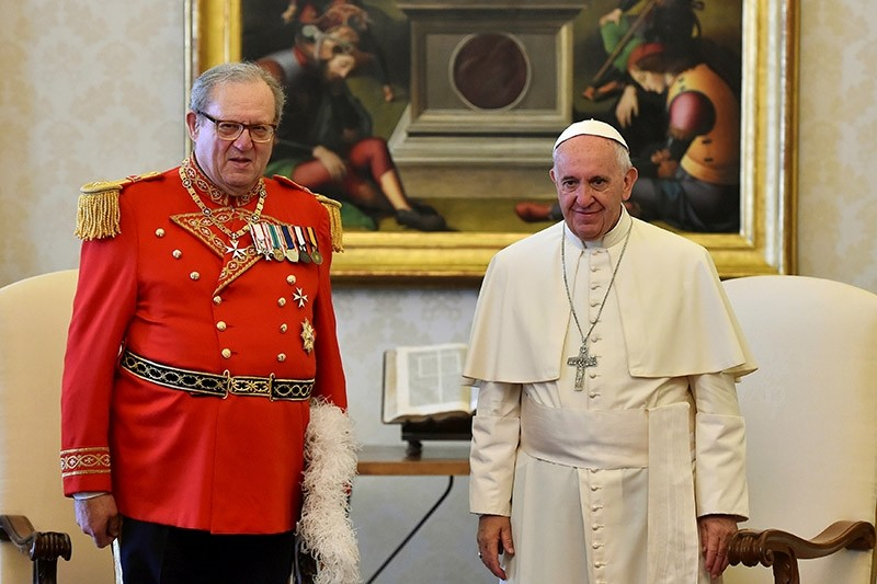 Pope Francis (R) meets Robert Matthew Festing, Prince and Grand Master of the Sovereign Order of Malta during a private audience at the Vatican on June 23, 2016. (Reuters File Photo)