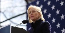 In speech at Trump hotel, Gillibrand calls Trump a coward