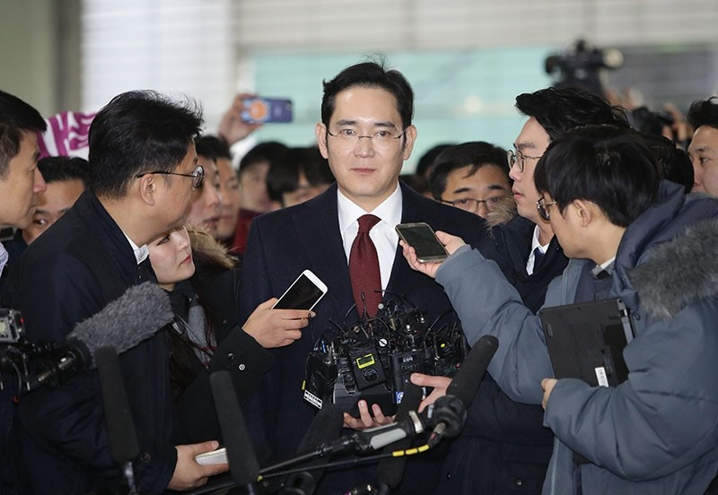 A file picture dated 12 January 2017 shows Lee Jae-yong, Vice Chairman of Samsung (C) arriving to the office of the Independent Counel for questioning in Seoul, South Korea. (EPA Photo)