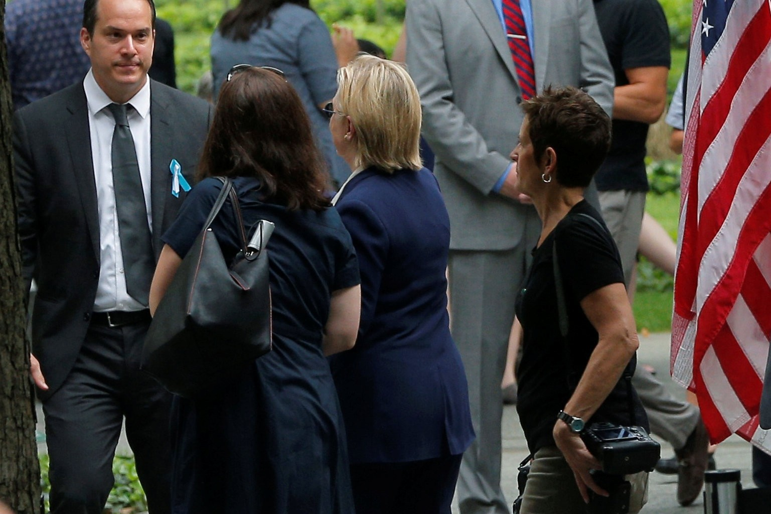 U.S. Democratic presidential candidate Hillary Clinton leaves ceremonies marking the 15th anniversary of the September 11 attacks at the National 9/11 Memorial in New York. (Reuters Photo)