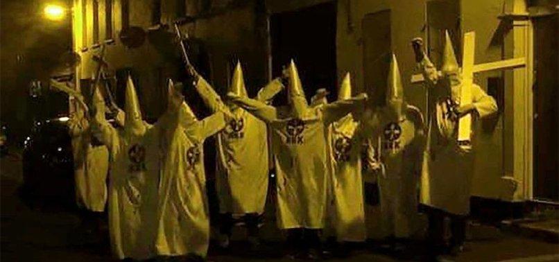 N. IRELAND POLICE PROBE KKK POSE OUTSIDE ISLAMIC CENTER