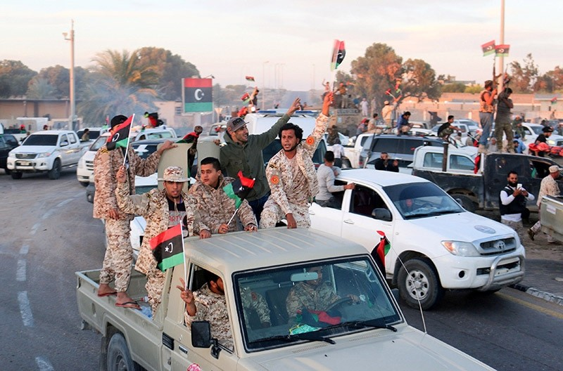 Fighters of Libyan forces allied with the U.N.-backed government celebrate after they finished clearing Ghiza Bahriya, the final district of the former Daesh stronghold of Sirte, Libya on Dec. 6, 2016. (Reuters Photo)