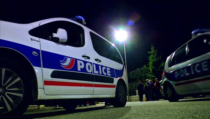 Still image taken from video shows police vehicles at the scene near where a French police commander was stabbed to death in front of his home, June 14, 2016 (Reuters)