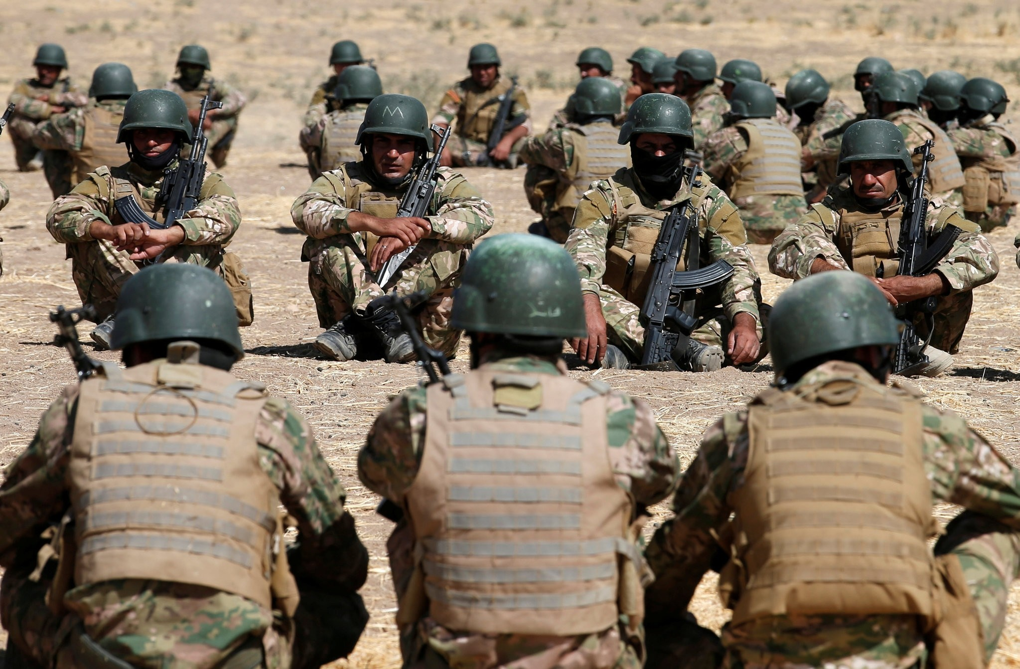 Fighters from predominantly Sunni Arab force take part in a training session before the upcoming battle to recapture Mosul in Bashiqa, October 6, 2016. (REUTERS Photo)