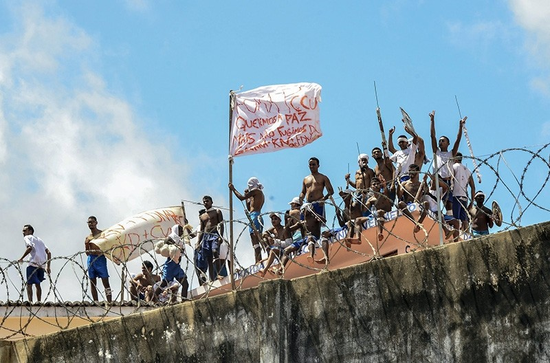 A group of inmates stand on a roof inside the State Penitentiary of Alcacuz in Nisia Floresta near Natal, Rio Grande do Norte, Brazil, Jan. 15, 2017. (EPA Photo)