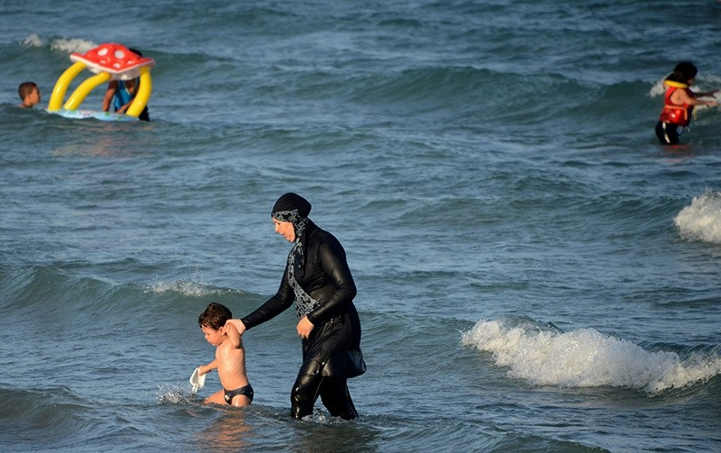A Muslim woman wears a burkini on a beach in in Marseille, France, Aug. 17, 2015 (AFP Photo)
