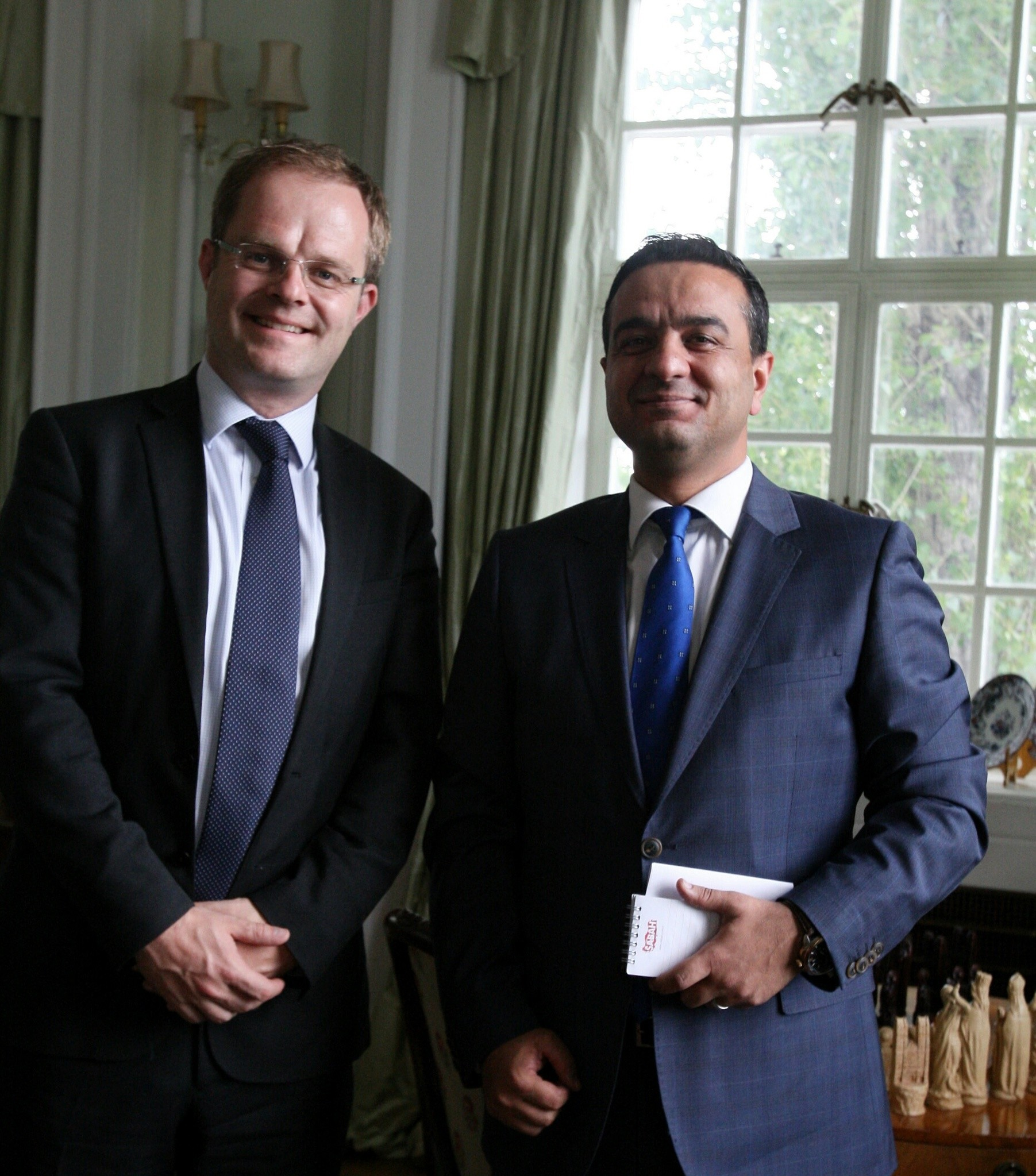 The U.K. special representative for Syria, Gareth Bayley (L) and Daily Sabah's Ali u00dcnal
