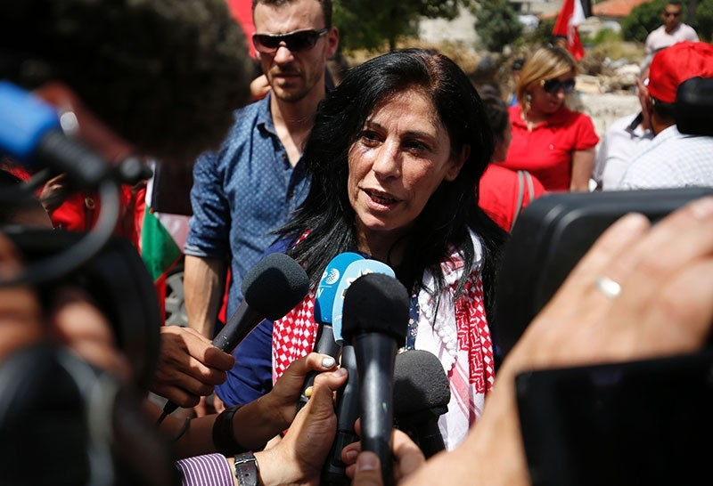 Khalida Jarrar greets speaks to reporters in her hometown, the West Bank city of Ramallah, following her release from an Israeli jail on June 3, 2016 (AFP)