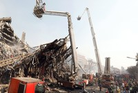 A high-rise building in Tehran engulfed by a fire collapsed on Thursday, killing at least 20 firefighters, Iranian state television quoted the city's mayor as saying on Thursday.
