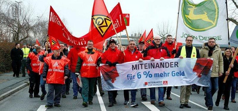 GERMAN INDUSTRIAL WORKERS WIDEN STRIKES IN WAGE DISPUTE