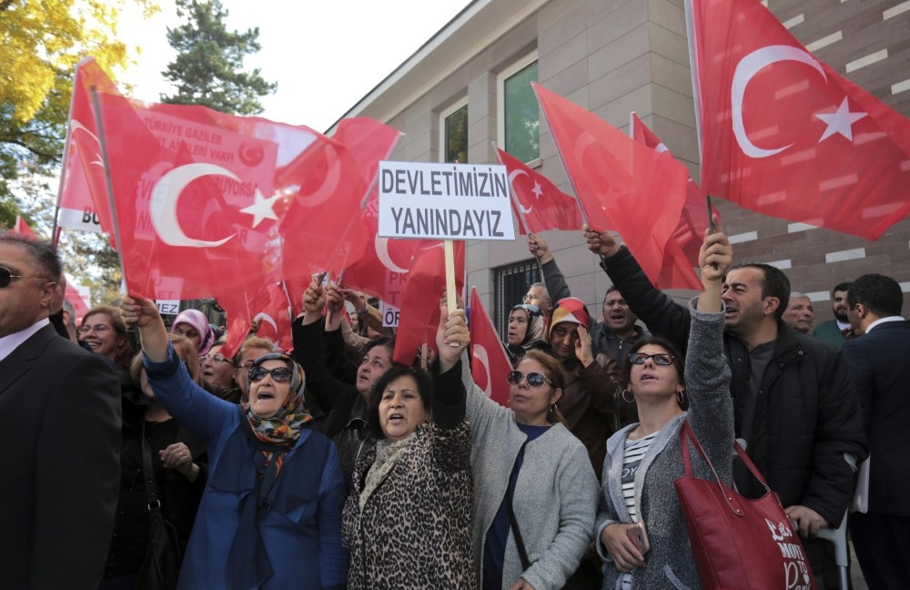 Turkish citizens staged a demonstration outside the French embassy in Ankara to protest France's support for PKK. The placard reads: ,We are with our State.,