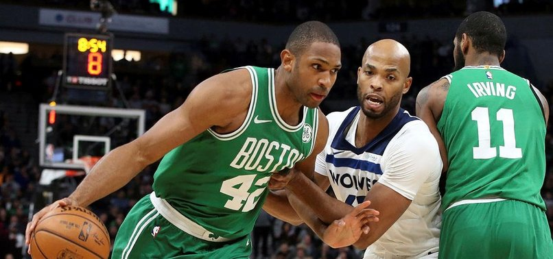 CELTICS DOWN WOLVES, SEAL PLAYOFF BERTH