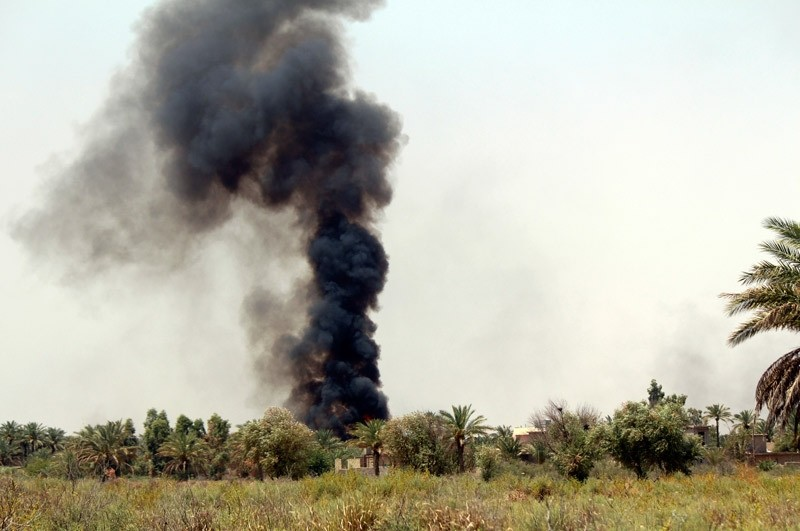 Smoke rises as Iraqi security forces backed by allied Shiite Popular Mobilization forces and Sunni tribal fighters attack Islamic State positions at Khalidiya Island in Anbar province, Iraq, Monday, Aug. 1, 2016.  AP Photo