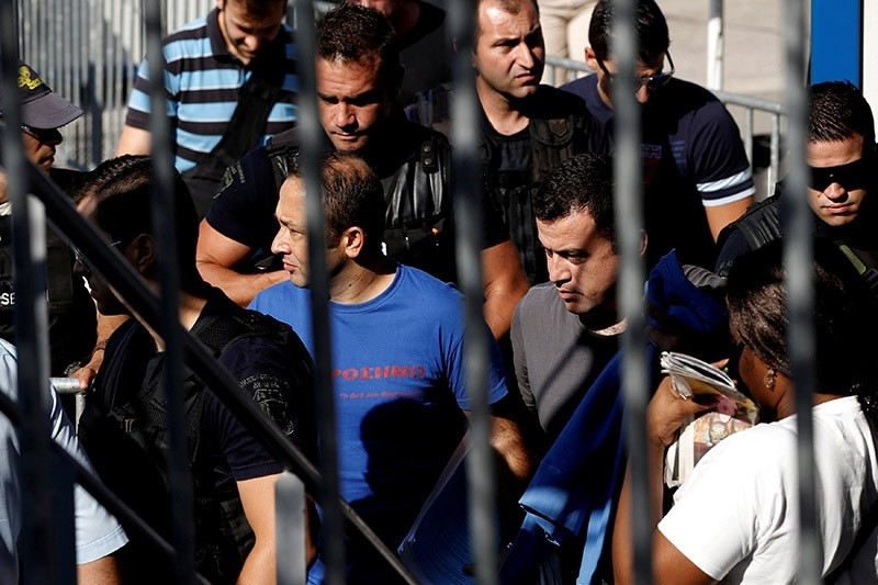 Two of the eight coup plotters are escorted by special police forces after the postponement of their interviews for asylum request at the Asylum Service in Athens, Greece, July 27, 2016. (Reuters Photo)