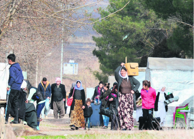 Refugees, terrorism & sharing of water resources are just a few of many issues of discussion between neighbors Iraq & Turkey. This picture shows Yazidi refugees from Iraq carry their belongings on Jan. 3 in Diyarbaku0131r as they change their camp.