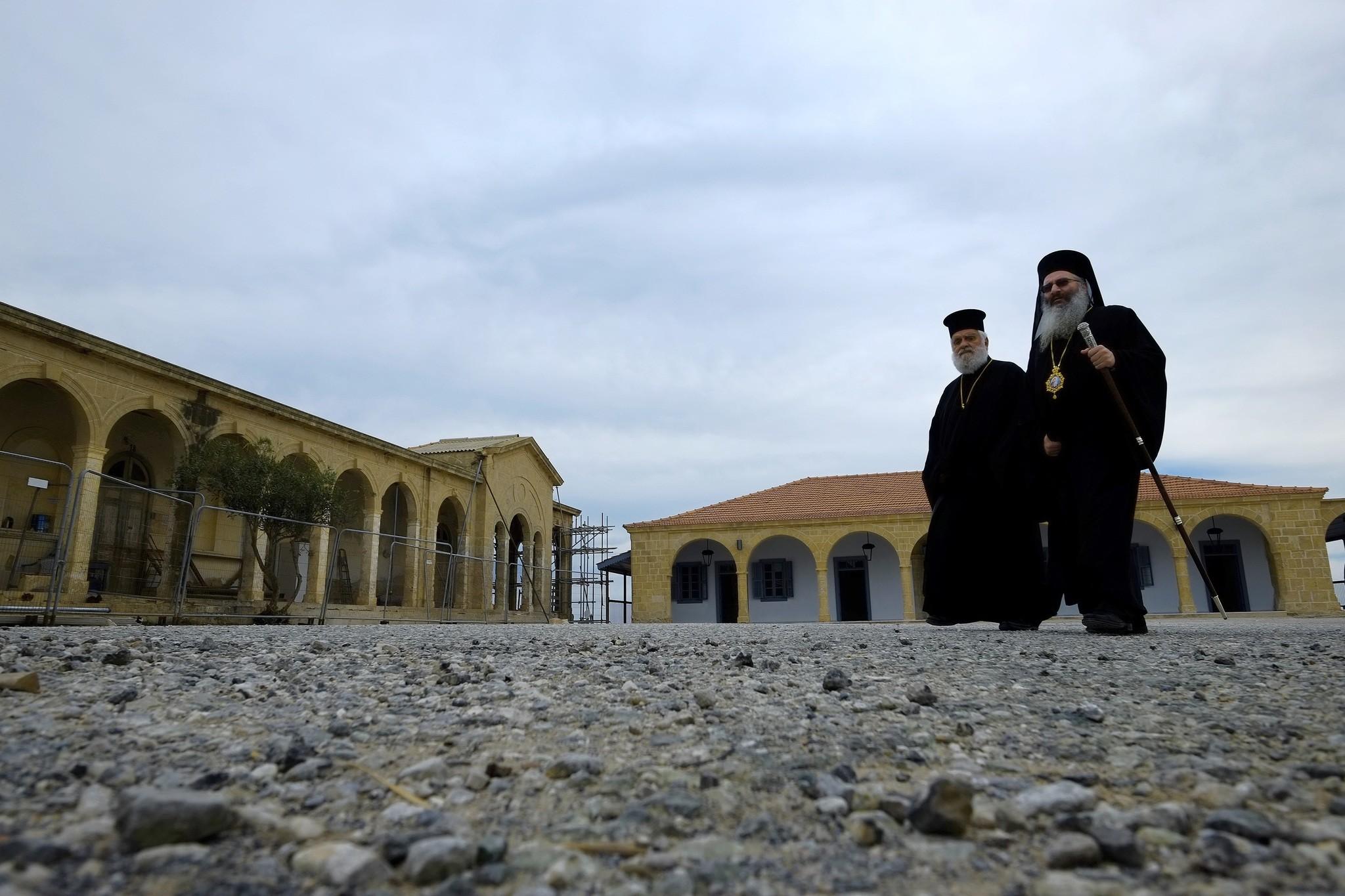 Greek Orthodox priests walk outside of the new restoration Greek Orthodox monastery of Apostolos Andreas in Karpasia. (AP Photo)