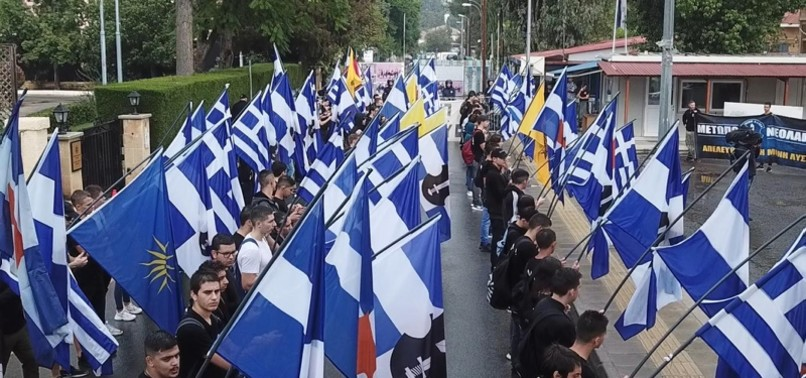 FAR-RIGHT GREEKS BURN TURKISH CYPRIOT FLAG DURING TRNC FOUNDATION CELEBRATIONS