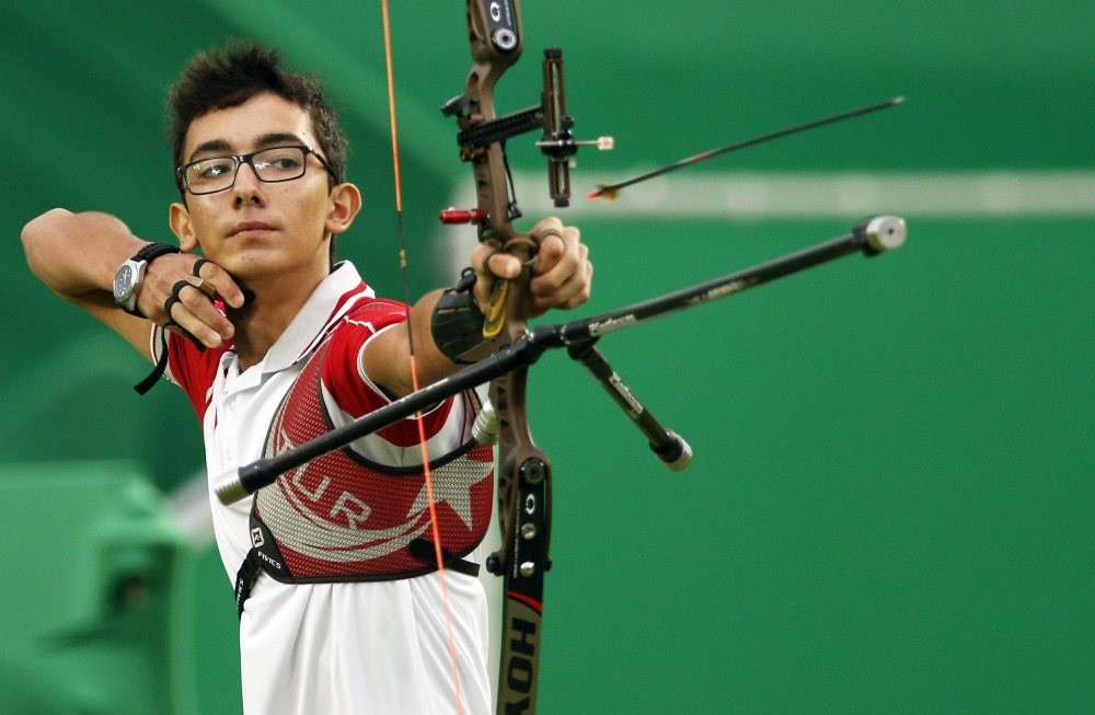 Mete Gazoz of Turkey takes aim during the menu2019s individual round 1/32 eliminations competition of the Rio 2016 Olympic Games Archery events.