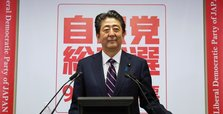 Japan's Abe to stay on as PM in party vote win