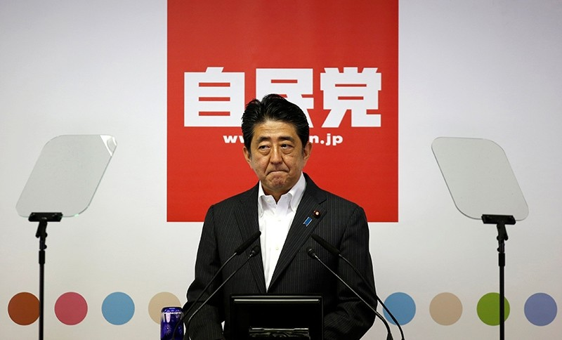 Japan's Prime Minister and leader of the ruling Liberal Democratic Party (LDP) Shinzo Abe attends a news conference following a victory in the upper house elections by his ruling coalition (Reuters Photo)