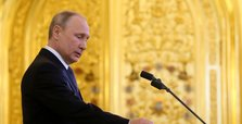 Putin uses World War II parade to boost support before vote