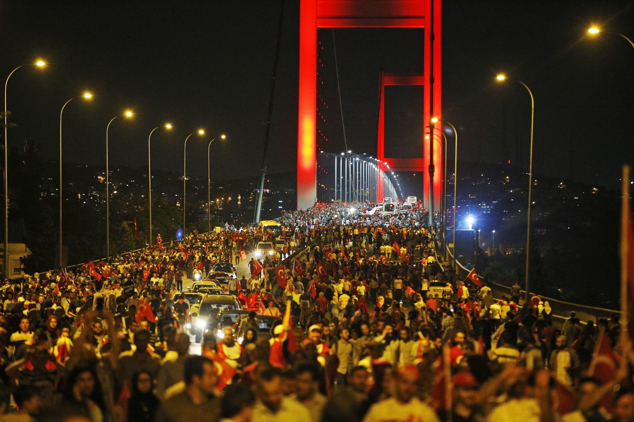 Turkish people protest on Istanbul's iconic Bosporus Bridge, late Thursday, July 21, 2016. (AP Photo)