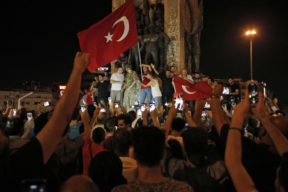 The people of Turkey gather against the Gulenist terrorists' coup attempt, waving Turkish flags, in Istanbul's Taksim square, July 16, 2016.