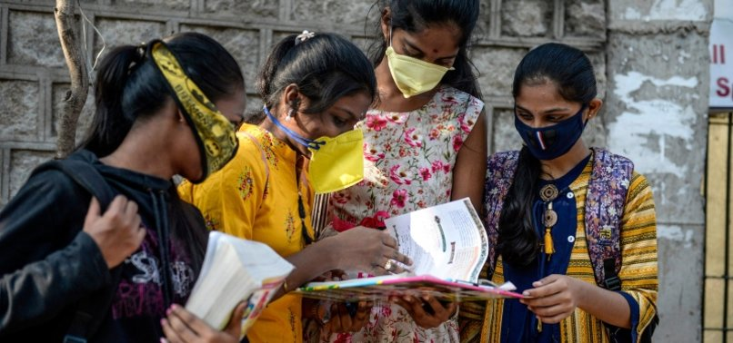 INDIA REPORTS OVER 8,000 NEW VIRUS CASES
