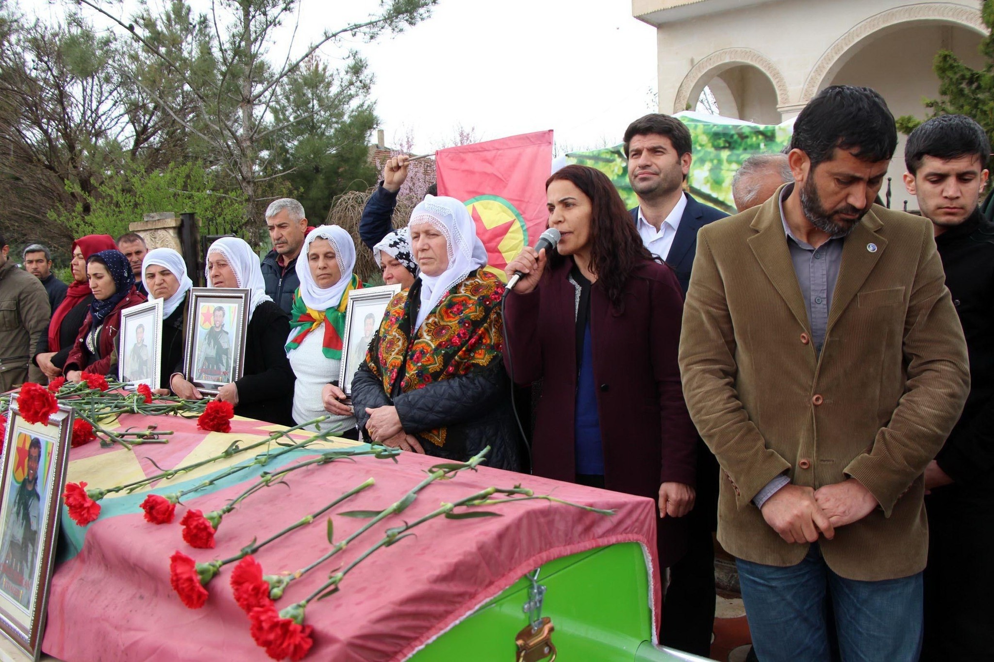 Besime Koca (F-2nd R) is seen in Batman, attending the funeral of a PKK terrorist, whose militant code name was 'Ciyager'. (DHA Photo)