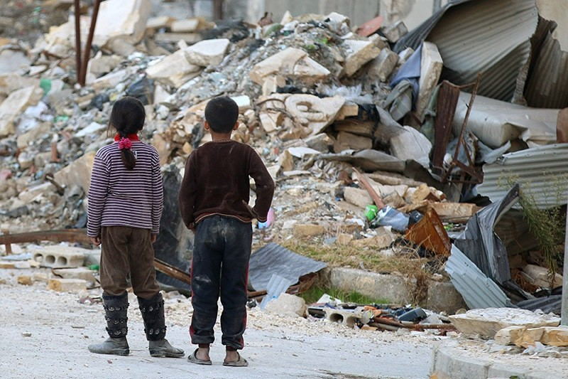 Children inspect rubble of damaged buildings in a rebel-held besieged area in Aleppo, Syria November 6, 2016. (Reuters Photo)