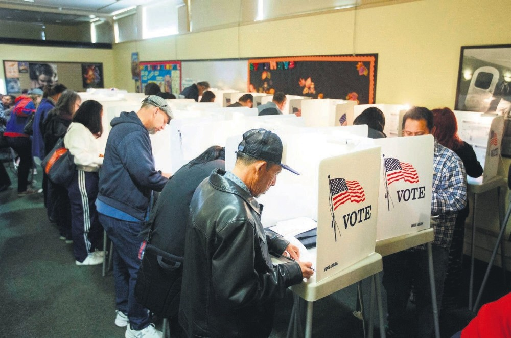 Voters cast their presidential ballots after waiting in a line for nearly four hours long during weekend early voting at a polling station in North Hollywood, California, Nov. 5.