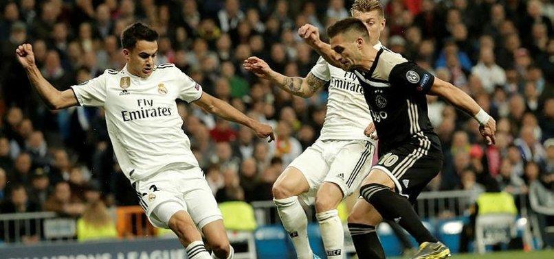 AJAX STUNS TITLE HOLDERS REAL MADRID