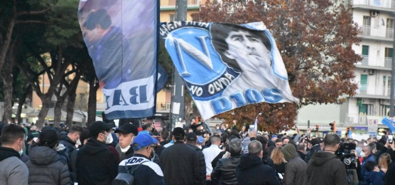FANS POUR INTO NAPLES STREETS TO PAY HOMAGE TO MARADONA