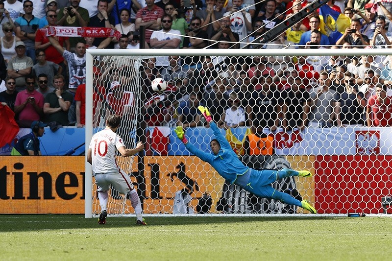 Poland's Grzegorz Krychowiak scores during the penalty shootout to win the match (Reuters Photo)