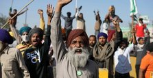 Indian farmers defiant against reform as Modi tries to calm anger