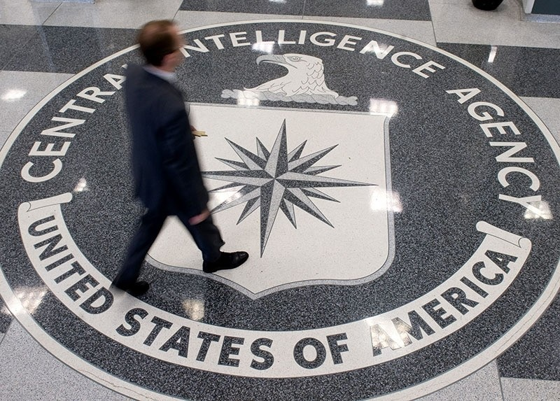 This file photo taken on August 14, 2008 shows a man crossing the Central Intelligence Agency (CIA) logo in the lobby of CIA Headquarters in Langley, Virginia. (AFP Photo)