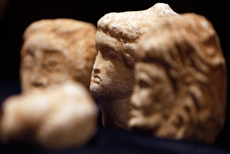 Recovered stone heads, ancient Roman artifacts, are seen on display in Tripoli, Libya. (AP Photo)
