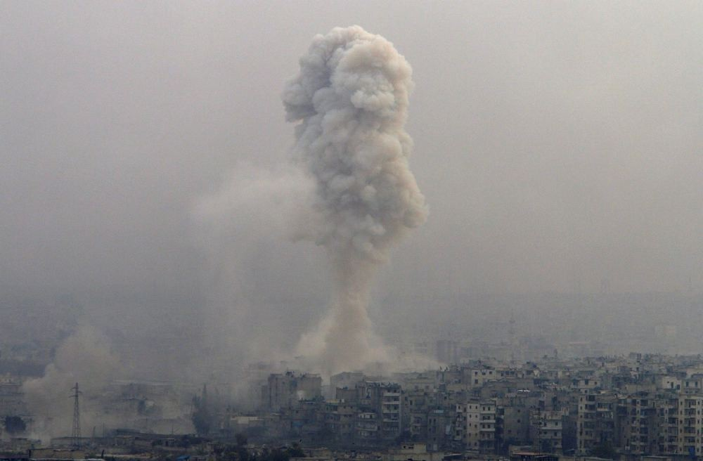 Smoke rises after airstrikes on opposition-controlled besieged eastern Aleppo, Syria, Dec. 5.