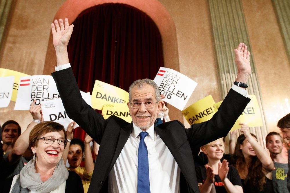 Austria's new president-elect, Alexander Van der Bellen (C), waves to supporters at the Palais Auersperg in Vienna, Austria, on May 22.