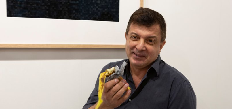 MAN EATS ART PIECE, A BANANA TAPED TO WALL, THAT SOLD FOR $120,000