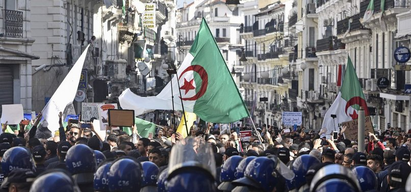 ALGERIANS FLOOD STREETS TO MARK PROTEST MOVEMENTS FIRST BIRTHDAY