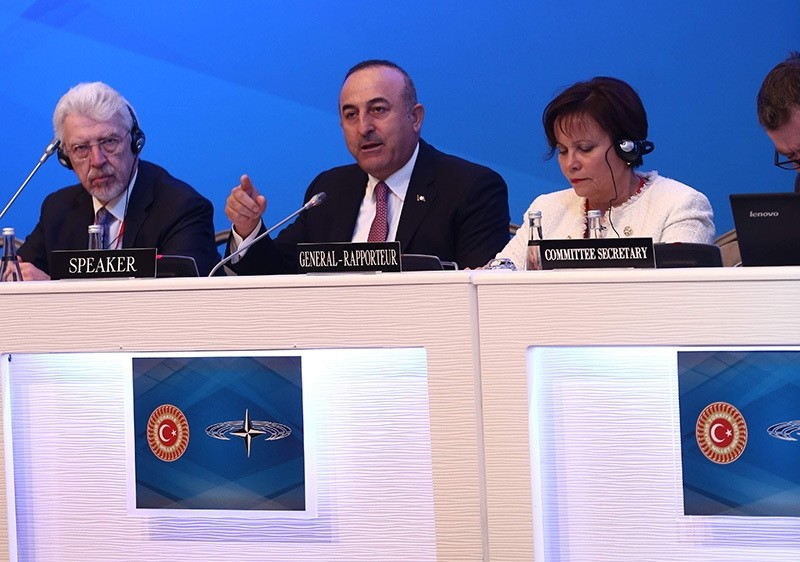Foreign Minister Mevlu00fct u00c7avuu015fou011flu (center) speaking at the Parliamentary Assembly of NATO meeting in Istanbul, November 19, 2016 (IHA Photo)