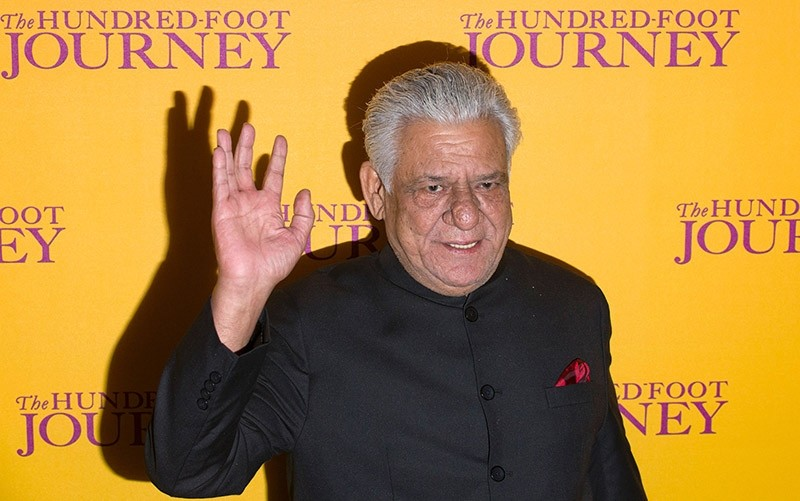 This file photograph taken on September 3, 2014, shows Indian Bollywood actor Om Puri waving as he attends the UK Gala Screening of the film, The Hundred Foot Journey, in central London. (AFP Photo)