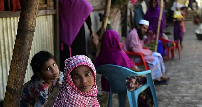 Rohingya refugees look on in a refugee camp in Teknaf, in Bangladesh's Cox's Bazar.
