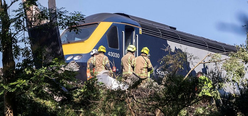 THREE DEAD IN SCOTLAND PASSENGER TRAIN DERAILMENT
