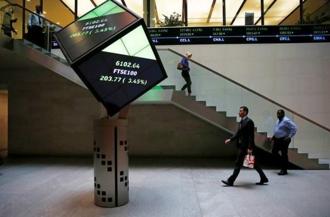 People walk through the lobby of the London Stock Exchange in London, Britain August 25, 2015.  REUTERS